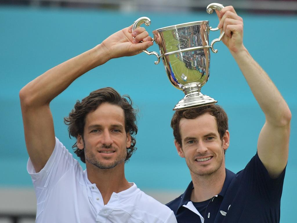 Britain's Andy Murray and Spain's Feliciano Lopez after their win in the men's doubles final at the ATP Fever-Tree Championships tournament. Picture: Daniel Leal-Olivas