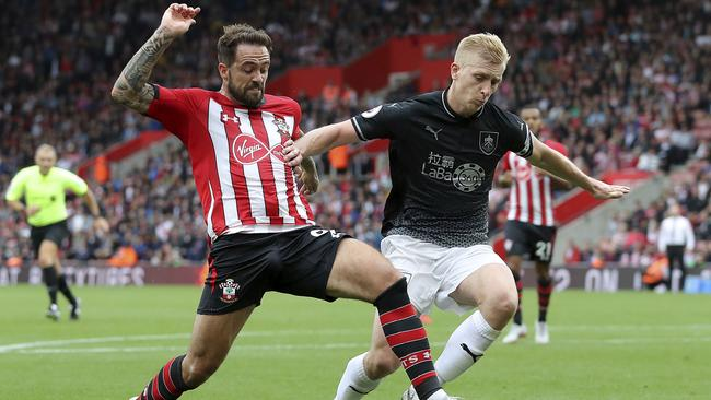 Southampton's new signing Danny Ings goes in for a tackle with Burnley's Ben Mee.