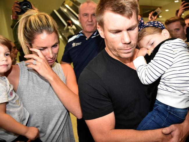 "Candice Warner and husband David after arriving back in Australia following the ""horror tour""."