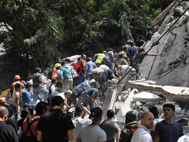 People remove debris of a collapsed building looking for possible victims in Mexico City. Picture: AFP