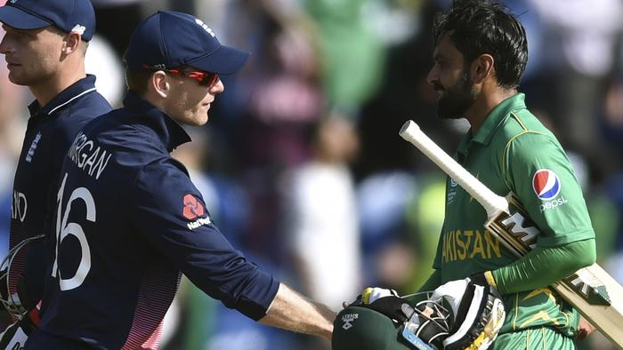 England's Eoin Morgan, left, shakes hands with Pakistan's Mohammad Hafeez after Pakistan' won the ICC Champions Trophy semifinal cricket match between England and Pakistan at The Cardiff Stadium in Cardiff, Wales, Wednesday, June 14, 2017. Pakistan won the match by 8 wickets with 77 balls remaining. (Joe Giddens/PA via AP)