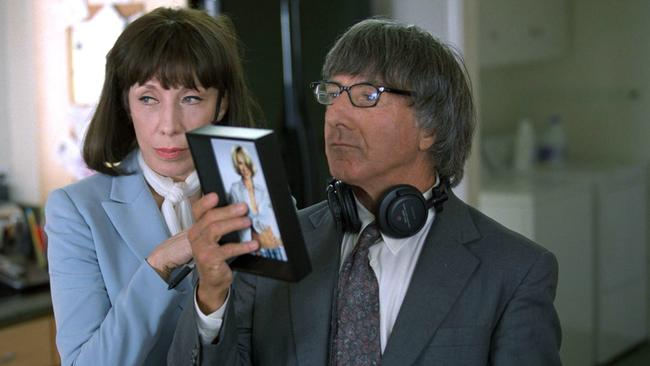 """Lily Tomlin with Dustin Hoffman in scene from film """"I Heart Huckabees"""". /Films/Titles/I/Heart/Huckabees"""
