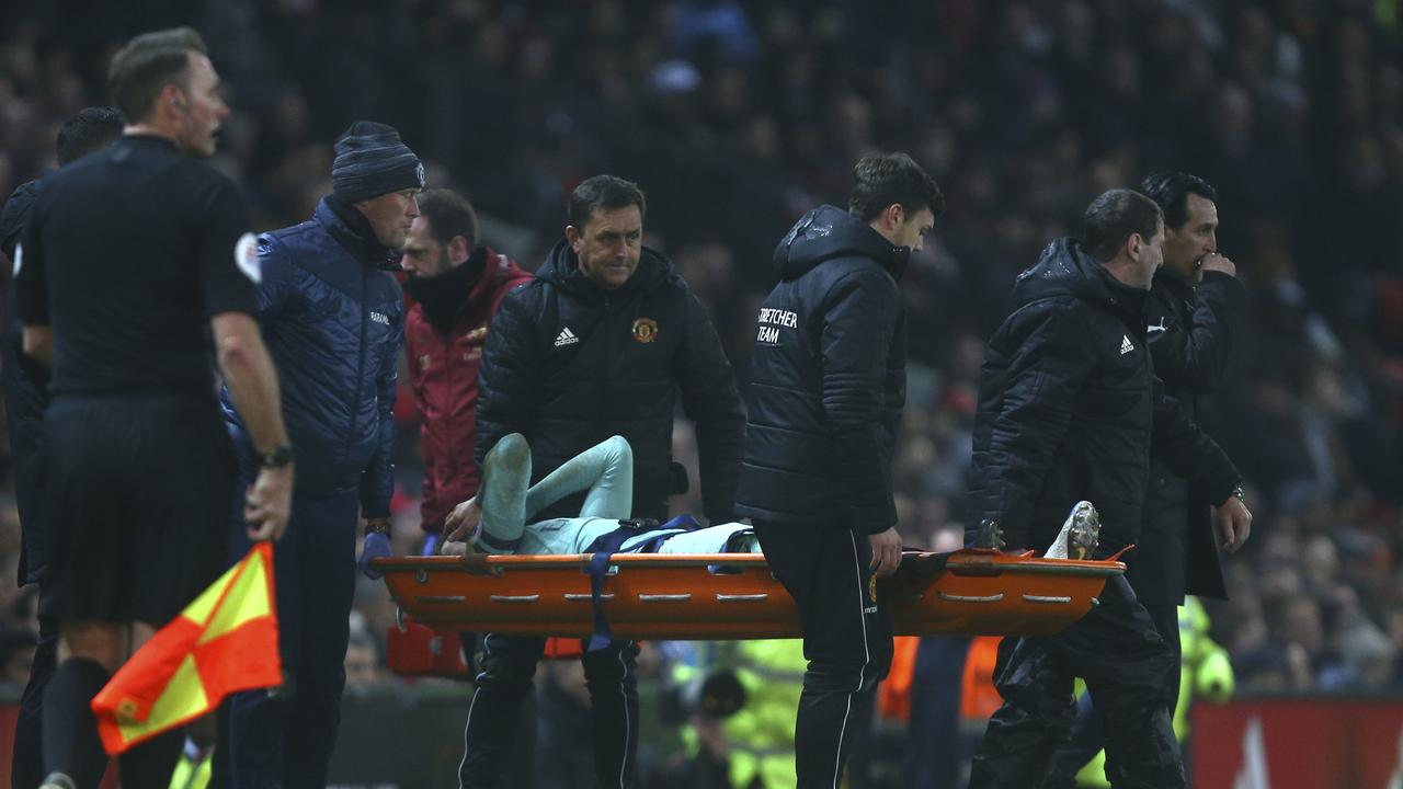 Arsenal's Rob Holding is stretchered off the pitch