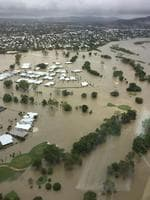 Aerial image posted by Queensland Government Air showing flooding in Townsville. Source: QGA.