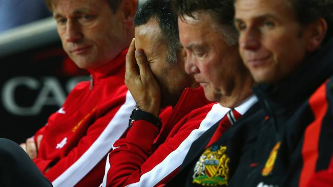 Assistant manager Ryan Giggs looks dejected during United's 4-0 defeat to MK Dons.