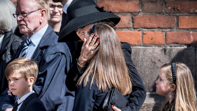 Danish Crown Princess Mary comforts her daughter princess Isabella next to prince Vincent and princess Josephine during the funeral service.