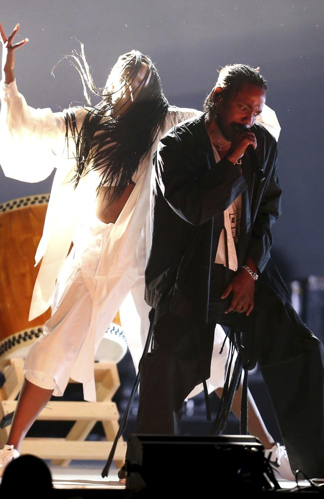 Kendrick Lamar, right, performs at the 60th annual Grammy Awards. Picture: AP