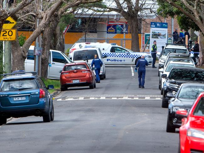 Forensic officers examining the scene in Melbourne's east. Picture Jay Town