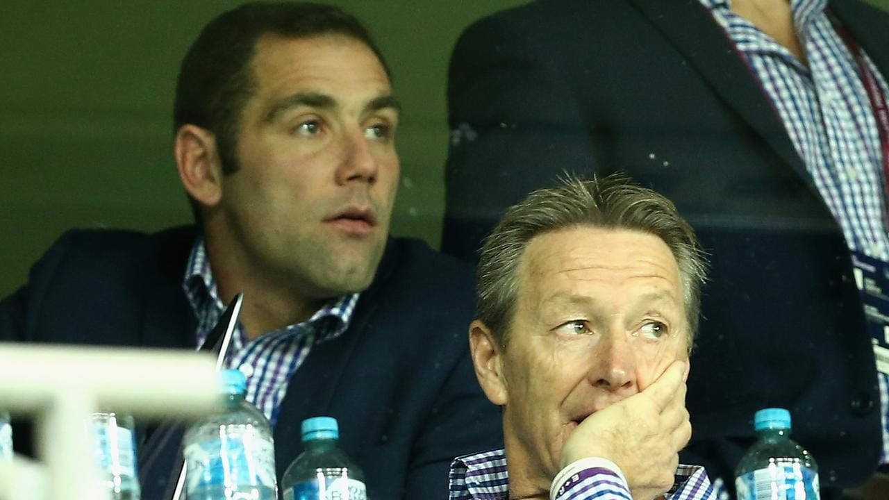 Craig Bellamy coach of the Melbourne Storm looks on along with Cameron Smith