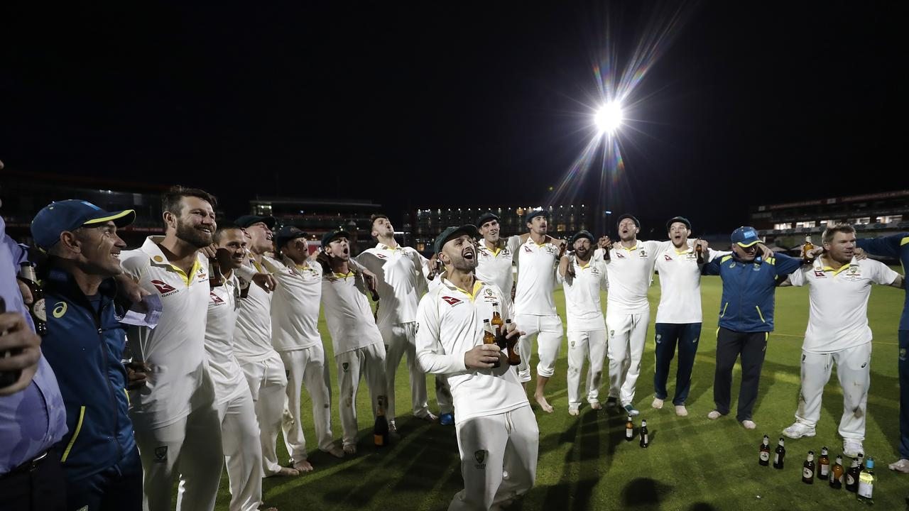 Nathan Lyon leads the team song.
