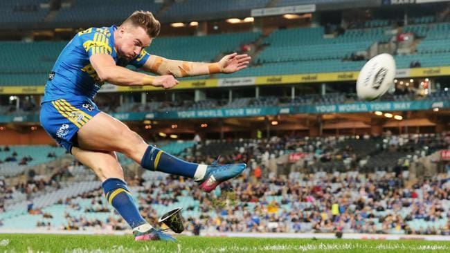 Clint Gutherson of the Eels converts from the sideline.