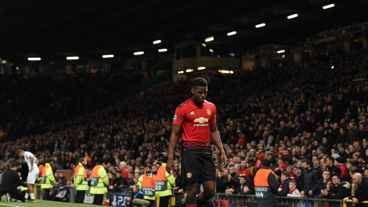 Manchester United's French midfielder Paul Pogba leaves the pitch after being shown a red card
