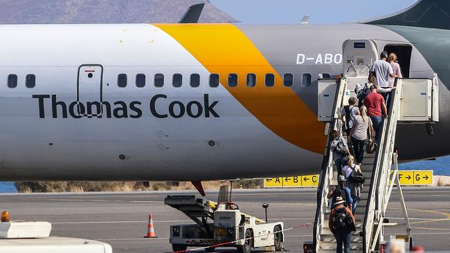 The British government helped tourists fly home from Crete on Monday. Picture: Costas Metaxakis/AFP