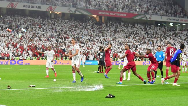 Fans throw bottles and flip-flops at the pitch during the 2019 AFC Asian Cup semi-final football match between Qatar and UAE. Picture: AFP
