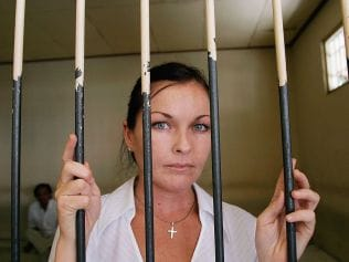Schapelle Corby behind bars in the holding cell at Denpasar District Court August 25, 2006 in Denpasar, Bali, Indonesia. Photo: Jason Childs/Getty Images.