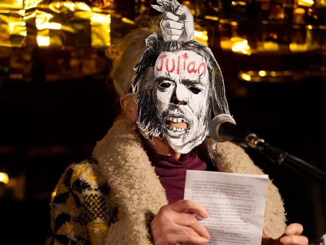 Fashion designer Dame Vivienne Westwood, wearing a mask, reads a statement during a protest against the extradition of WikiLeaks founder Julian Assange. Picture: AFP