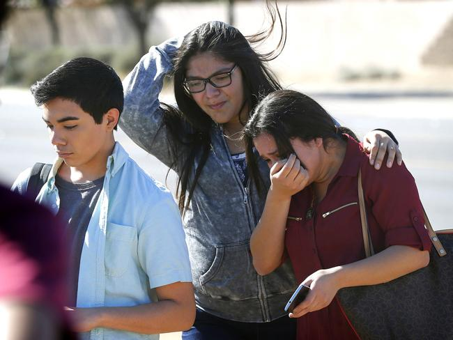 Students walk to their parents after being released from lockdown.