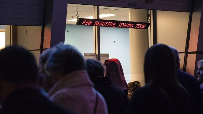 Fans queuing outside the box office at Qudos Bank Arena in Sydney after Pink was forced to postpone a second show on medical advice. Picture: AAP Image/Erik AndersonSource:AAP