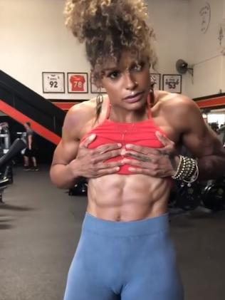Melissa showing off her jacked abs.
