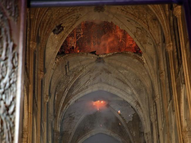 Flames and smoke are seen in the interior of the cathedral. Picture: Philippe Wojazer/AP