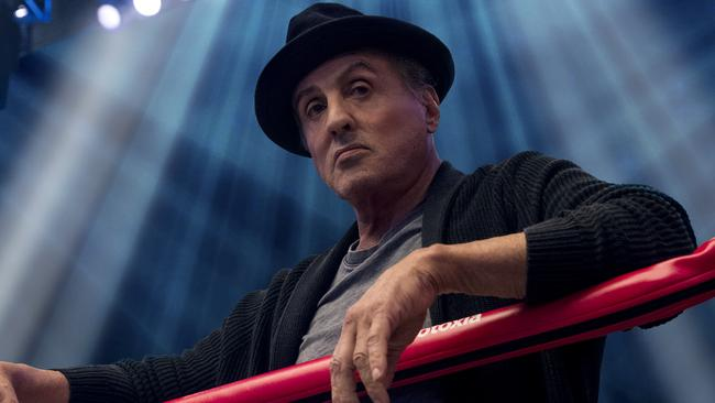 Never thought of Sylvester Stallone as a hat person, but it totally works. (Barry Wetcher/Metro Goldwyn Mayer Pictures/Warner Bros. Pictures via AP)