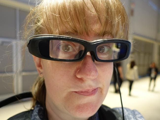Test run ... on the head, the SmartEyeglass spectacles are heavier than typical glasses frames, with arms that sit wider than normal. Picture: Jennifer Dudley-Nicholson