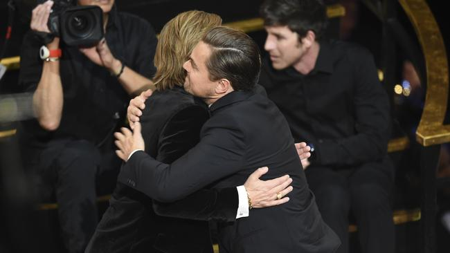 Brad Pitt (left) is congratulated by Leonardo DiCaprio at the Oscars. Picture: AP Photo/Chris Pizzello