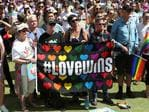 Same-sex couples and their friends and family gathered at Queens Gardens this morning to watch the SSM result announced live by the ABS. Picture: Peter Wallis