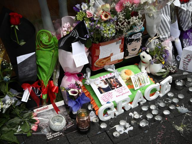 Tributes are pictured outside the CityLife Hotel on Queen Street in Auckland, New Zealand. Picture: Getty