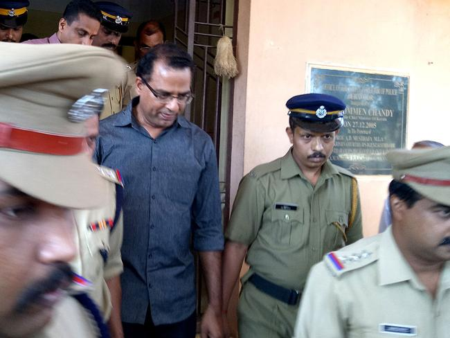 Indian police officials escort priest Robin Vadakkumchery (C), guilty of raping a 16-year-old schoolgirl who became pregnant and gave birth to a baby. Picture: STR/AFP