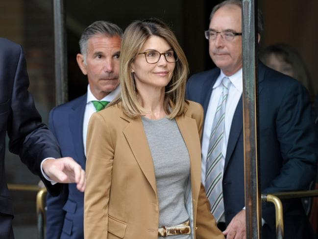 Actress Lori Loughlin smiles as she exits the courthouse after facing charges for allegedly conspiring to commit mail fraud and other charges in the college admissions scandal. Picture: Joseph Prezioso / AFP