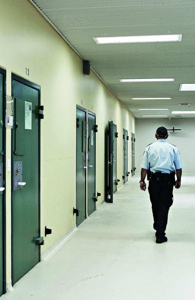 Officer in the corridor outside a row of cell doors at Supermax prison in Goulburn. Picture: Guy Bailey