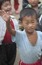 Skinny Young Boy Raising Hand, Hamhung, North Korea. Picture: Eric Lafforgue/Exclusivepix Media/australscope