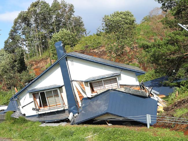 A house is damaged by landslides caused by an earthquake in Atsuma town, Hokkaido. Picture: JIJI PRESS/AFP
