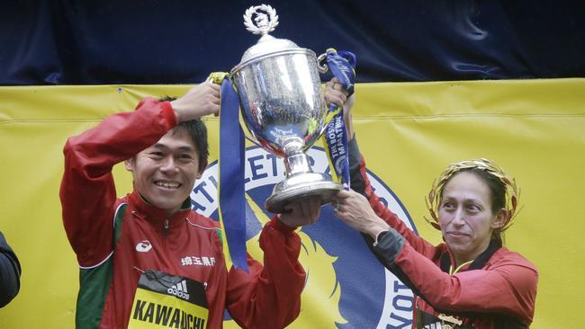 Yuki Kawauchi and Desiree Linden celebrate their wins.
