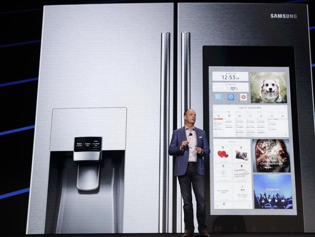 Tim Baxter, president and CEO of Samsung Electronics North America, introduces the new Family Hub smart refrigerator at CES International in Las Vegas.