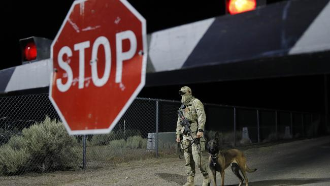 An armed security guard stood at one of the entrances the night before the mock event took place. Picture: AP.