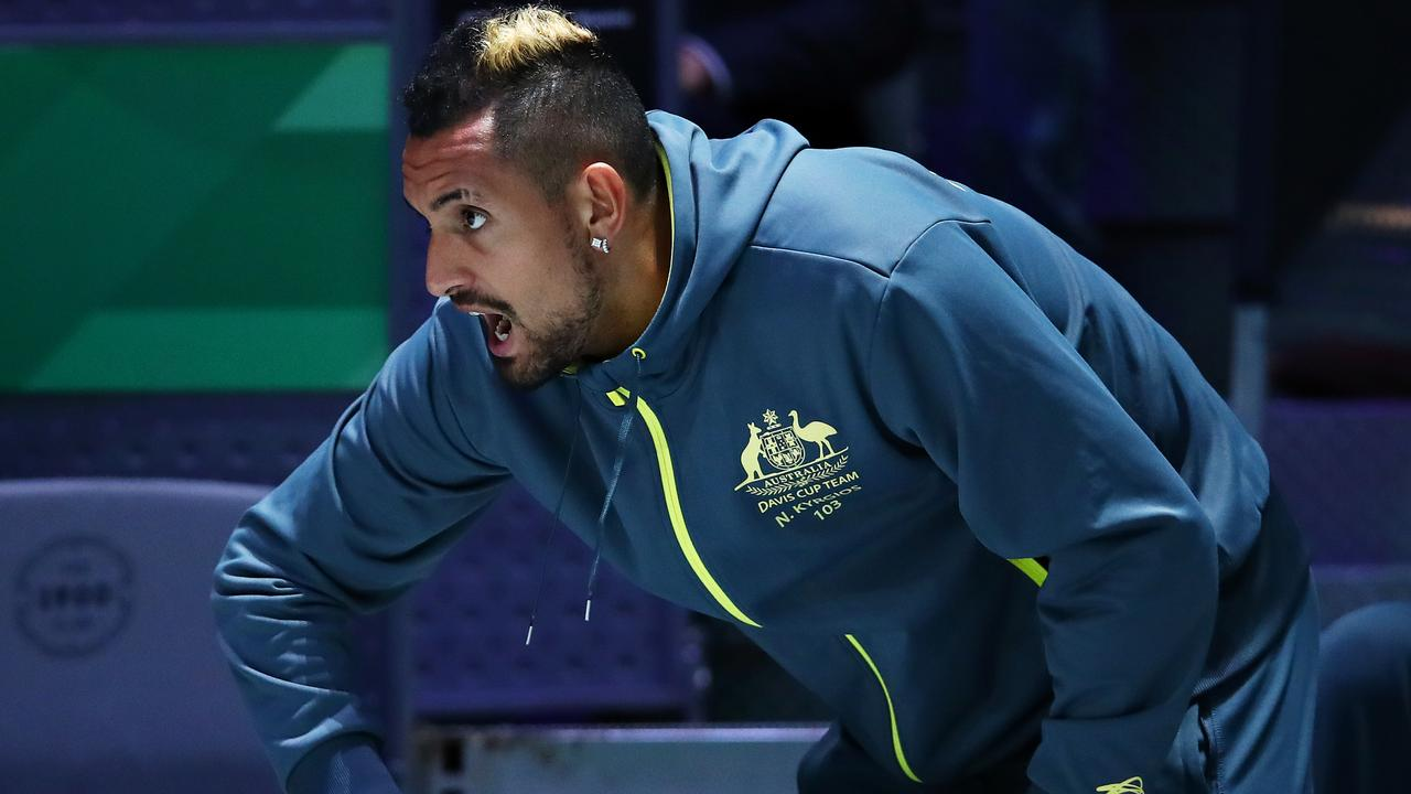 Nick Kyrgios watches the action during the quarter final singles match between de Minaur and Shapovalov.