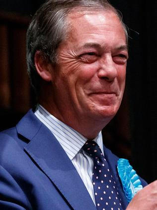 Chuffed: Nigel Farage has won the highest number of seats for a UK party and is ready to fight a UK election. Picture: Tolga Akmen/AFP.