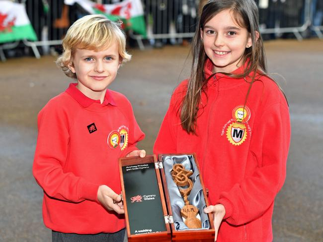 Harry Smith and Megan Taylor, both from Marlborough Primary School, with a wedding gift for Britain's Prince Harry and his fiancee US actress Meghan Markle. Picture: AFP PHOTO / POOL / Ben Birchall