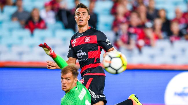 Chris Ikonomidis slots home his first goal for the Wanderers.