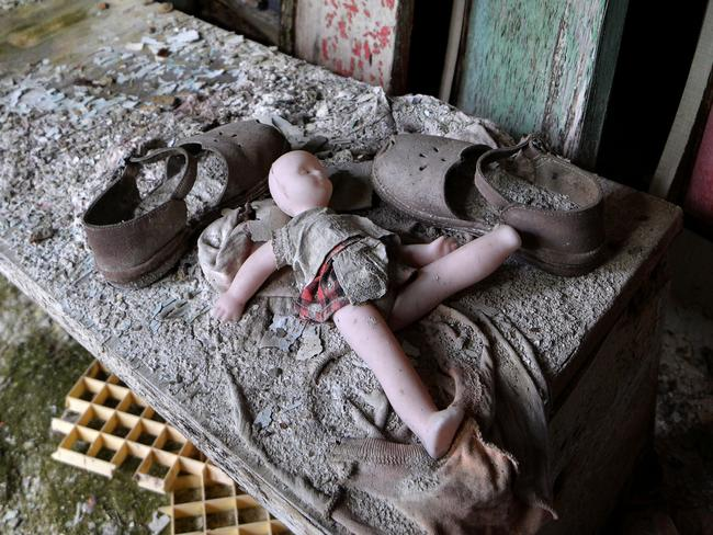 """A doll and shoes lay on a bench in a nursery school of the """"ghost town"""" of Pripyat near the Chernobyl Nuclear Power Plant. Picture: Genya Savilov"""