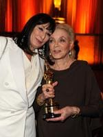 Bacall holds her honorary Oscar as she's hugged by Anjelica Huston as they attend the Academy of Motion Picture Arts and Sciences' Inaugural Governors Awards held at the Grand Ballroom in 2009 in Los Angeles, California. Picture: Getty