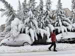 A man walks during a heavy snowfall in Hortiatis, 40km north of Thessaloniki, on February 26, 2018. Picture: AFP PHOTO / SAKIS MITROLIDIS