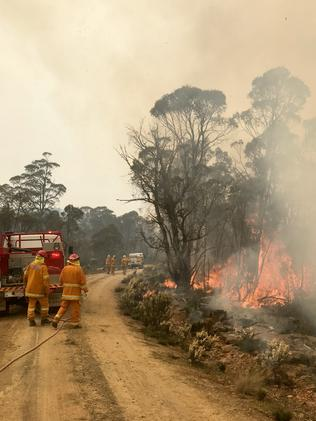 Firefighters at work battling blazes in Tasmania's Central Highlands near Miena. Picture: TARA FELTS