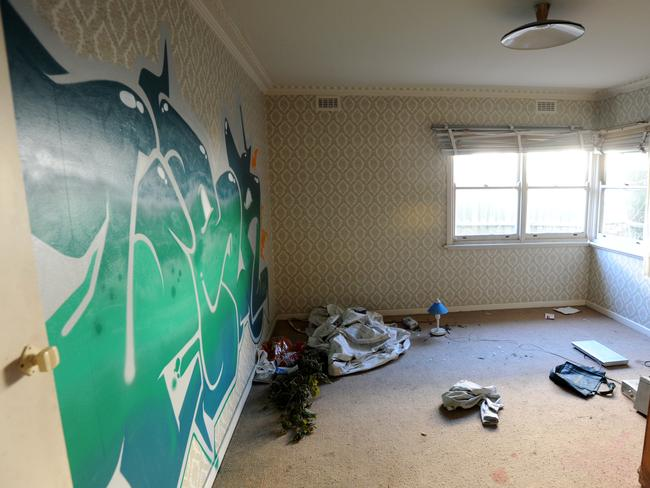 The house at Bundoora was strewn with items and had little in the way of furniture. Picture: Andrew Henshaw