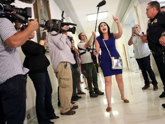 Laura Loomer, who was recently suspended by Twitter, being escorted from a 2018 congressional hearing. Picture: Reuters