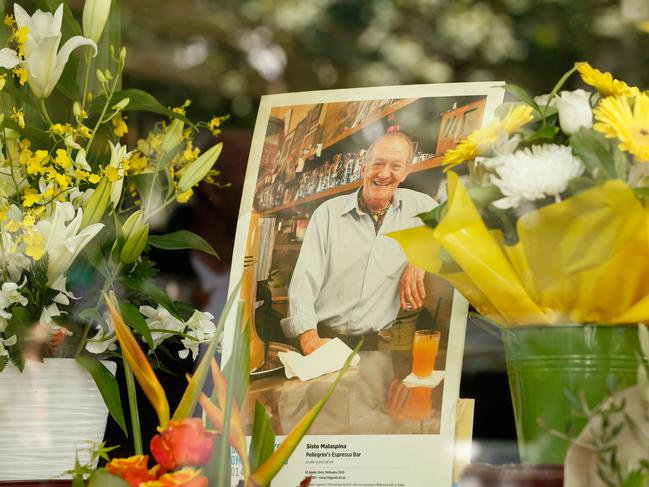 Mourners lay floral tributes at the iconic Melbourne cafe Pellegrinis. Picture: Darrian Traynor/Getty Images