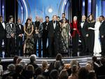 "The cast, crew and producers of ""The Assassination of Gianni Versace: American Crime Story"" accepting the award for best limited series or motion picture made for TV during the 76th Annual Golden Globe Awards. Picture: AP"