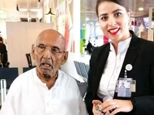 Mr Sivananda with a worker at Abu Dhabi airport.